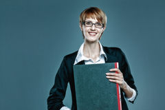 Friendly business woman holding a folder Royalty Free Stock Photography