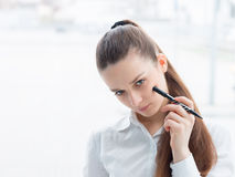 Friendly business woman holding a pen Royalty Free Stock Photography