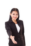 Friendly business woman offering a shake hand gesture Royalty Free Stock Photos