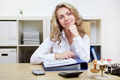 Friendly business woman in office Royalty Free Stock Image