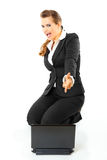 Friendly business woman pointing finger at laptop Royalty Free Stock Photo
