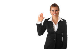 Friendly business woman showing salutation gesture. Friendly modern business woman showing salutation gesture isolated on white background stock images