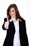Friendly business woman with thump up Royalty Free Stock Images