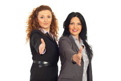 Friendly business women gives handshake Royalty Free Stock Photos