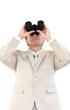 Friendly businessman with binoculars Stock Images