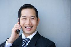 Friendly businessman with cellphone Royalty Free Stock Images