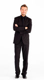 Friendly businessman with crossed arms Stock Photos