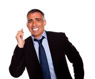 Friendly businessman crossing fingers Stock Images