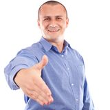Friendly businessman handshake. Young friendly businessman handshake, isolated over white background Stock Photos