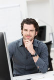 Friendly businessman at his desk Stock Photos