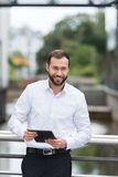 Friendly businessman with a lovely smile Stock Photography
