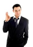 Friendly businessman showing ok sign Stock Images
