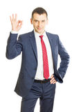 Friendly businessman showing ok sign Stock Photo