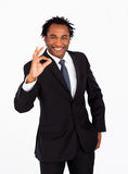 Friendly businessman showing okay sign Stock Photos