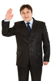 Friendly businessman showing salutation gesture Royalty Free Stock Image