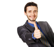 Friendly businessman showing thumbs up sign Stock Image