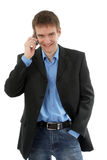 The friendly businessman speaks by phone Stock Images