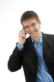 The friendly businessman speaks by phone Stock Photo