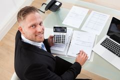 Friendly businessman at work in the office Stock Photo