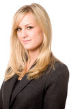 Friendly Businesswoman. Approachable Blond Businesswoman Wearing a Dark Suit Royalty Free Stock Photo