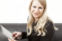 Friendly businesswoman hold´s tablet PC Royalty Free Stock Photos