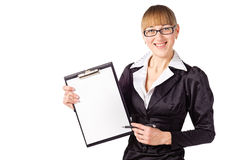 Friendly businesswoman holding pad and pen Royalty Free Stock Photography