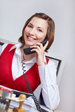 Friendly businesswoman on the phone Royalty Free Stock Images