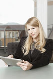 Friendly businesswoman with tablet PC Stock Images