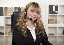 Friendly businesswoman wearing a headset Royalty Free Stock Photos