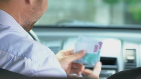 Friendly cab driver taking money from client, taxi service, transportation stock footage
