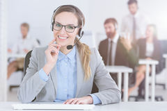 Friendly call center worker Stock Images