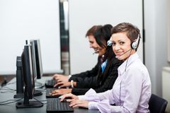 Friendly callcenter agent operator with headset Royalty Free Stock Photo