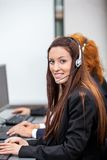 Friendly callcenter agent operator with headset telephone Stock Image
