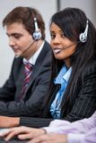 Friendly callcenter agent operator with headset telephone Stock Images