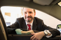 Friendly car driver ready for work Royalty Free Stock Image