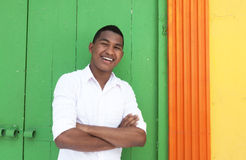 Friendly caribbean guy in front of a colorful wall Royalty Free Stock Photo