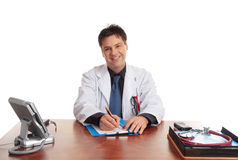Friendly Caring Doctor. Friendly smiling  medical practitionerr in consultation room or office Royalty Free Stock Photos