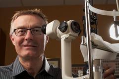Friendly caring optometrist Stock Photo