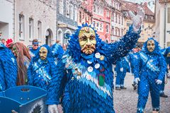 Friendly carnival witch in blue red robe, looks diagonally at the camera. At the carnival in southern Germany royalty free stock images