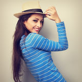 Friendly casual woman in blue top and straw hat looking. Vintage. Toned portrait Royalty Free Stock Photography