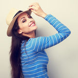 Friendly casual woman in blue top and straw hat posing and looki Royalty Free Stock Photos