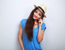 Friendly casual woman in hat looking happy. On blue background Royalty Free Stock Photography