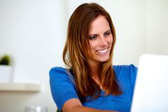 Friendly caucasian blonde lady smiling. Portrait of a friendly caucasian blonde lady smiling while is using a computer Stock Photos