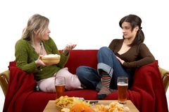 Friendly chat. Two cheerful friends talking, separate on white Royalty Free Stock Image