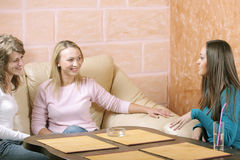 Friendly chat. Three young women have friendly chat in cafe Royalty Free Stock Photo