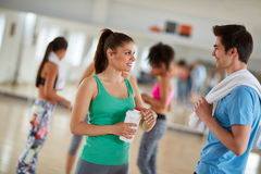 Friendly chat between boy and girl at gym Royalty Free Stock Photography