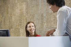 Friendly Chat At Workplace Royalty Free Stock Images