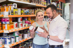 Friendly cheerful couple choosing paint Stock Images