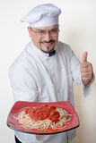 Friendly Chef With Plate of Gluten-Free Quinoa Spaghetti Stock Images