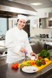Friendly chef preparing vegetables Royalty Free Stock Photos